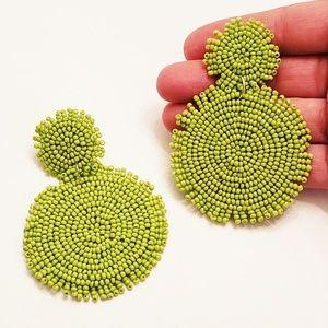 Glass beaded green eye catching earrings